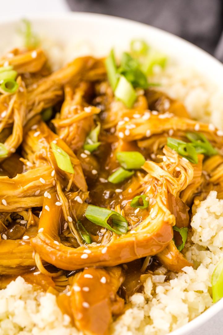 Close up of teriyaki chicken and cauliflower rice