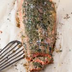 oven baked salmon on parchment paper with fish spatula