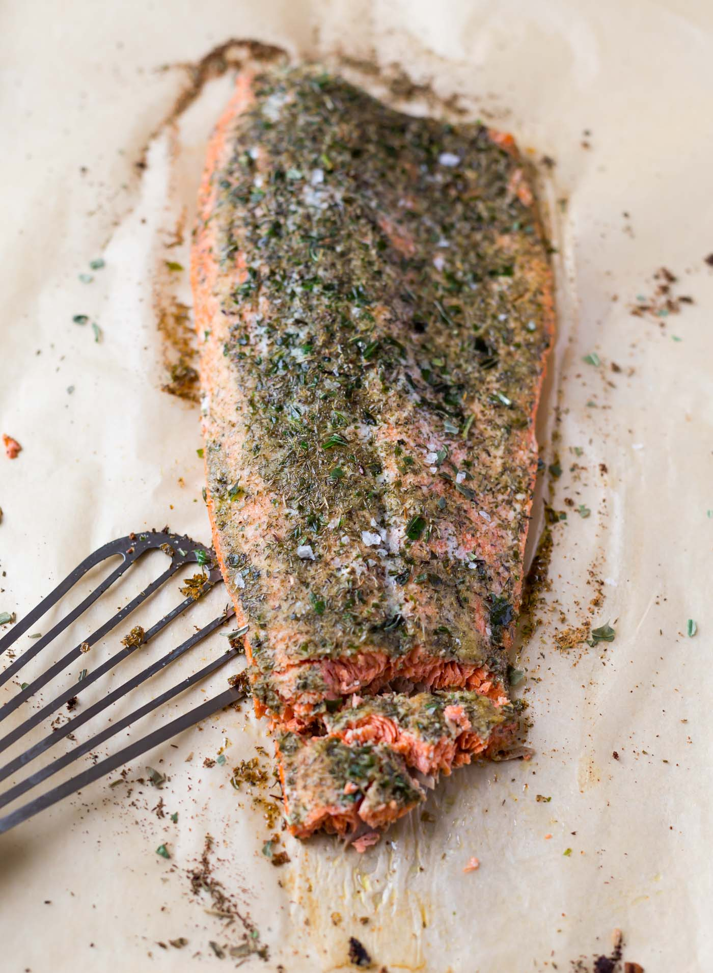 Baked salmon fillet on parchment paper with fish spatula