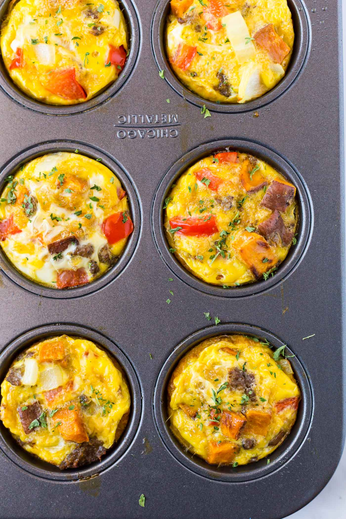 Baked egg muffins in muffin tin pan