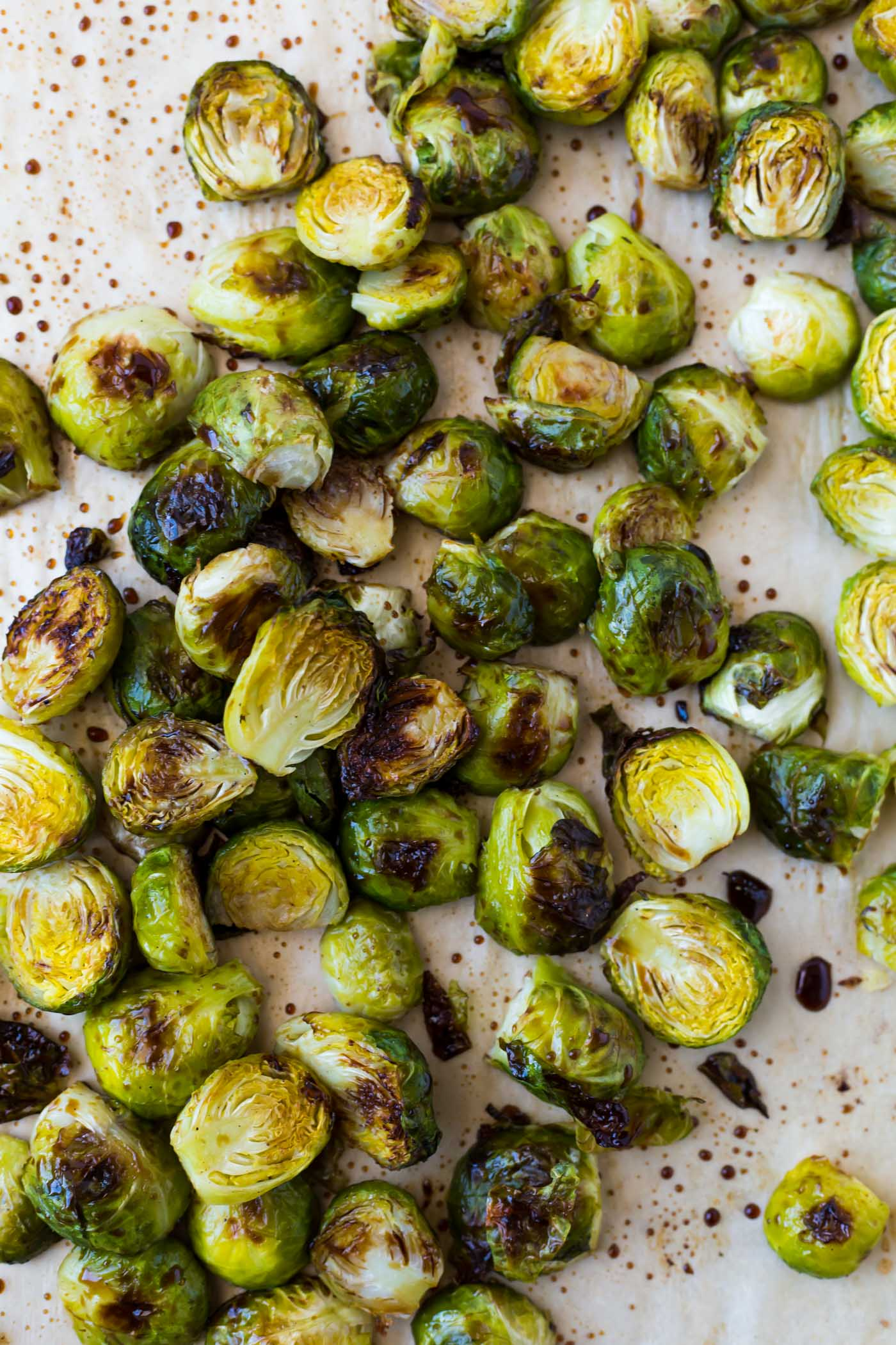 roasted brussels sprouts with balsamic vinegar on baking sheet