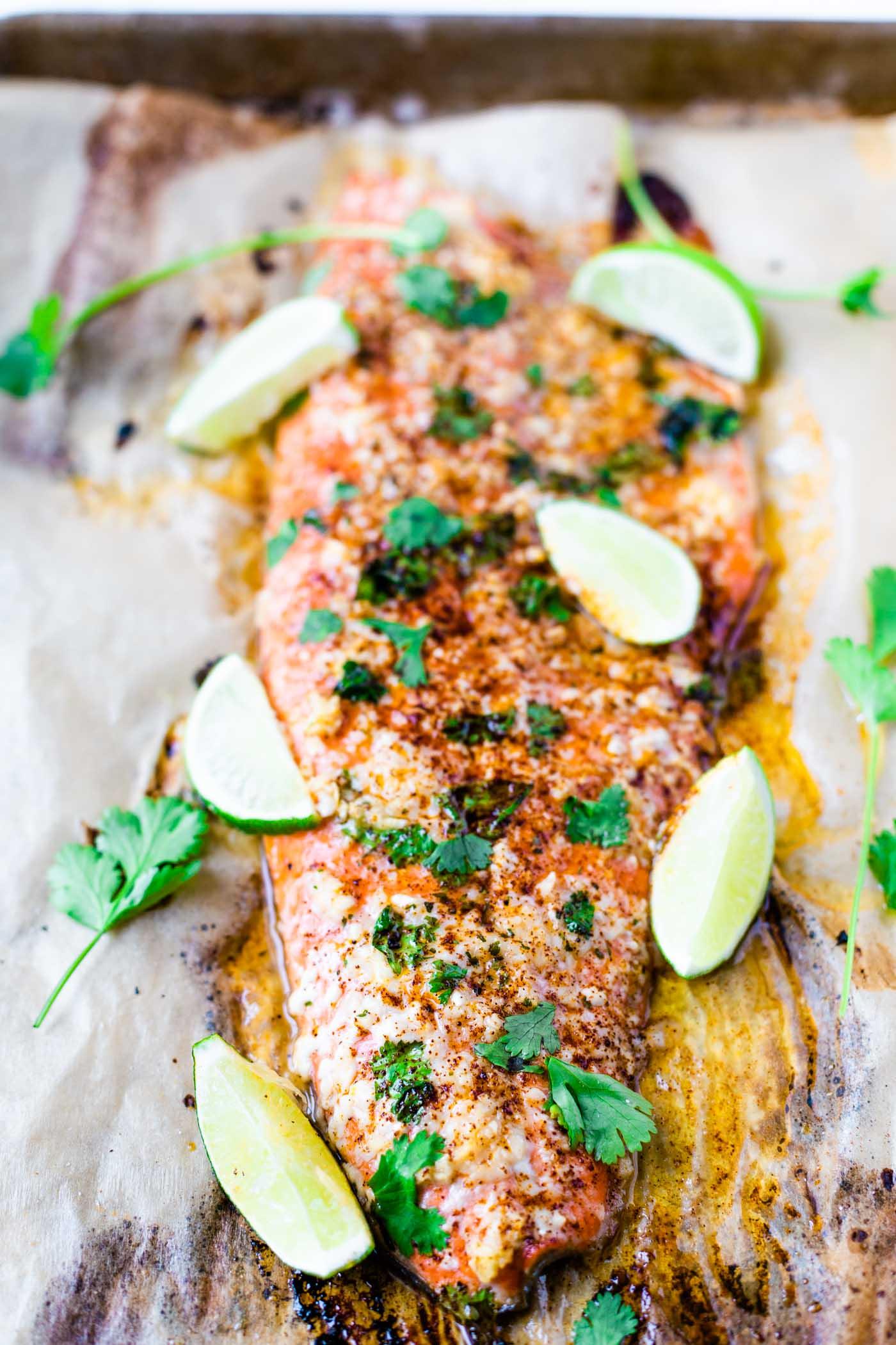 Baked honey cilantro lime salmon filet on baking sheet