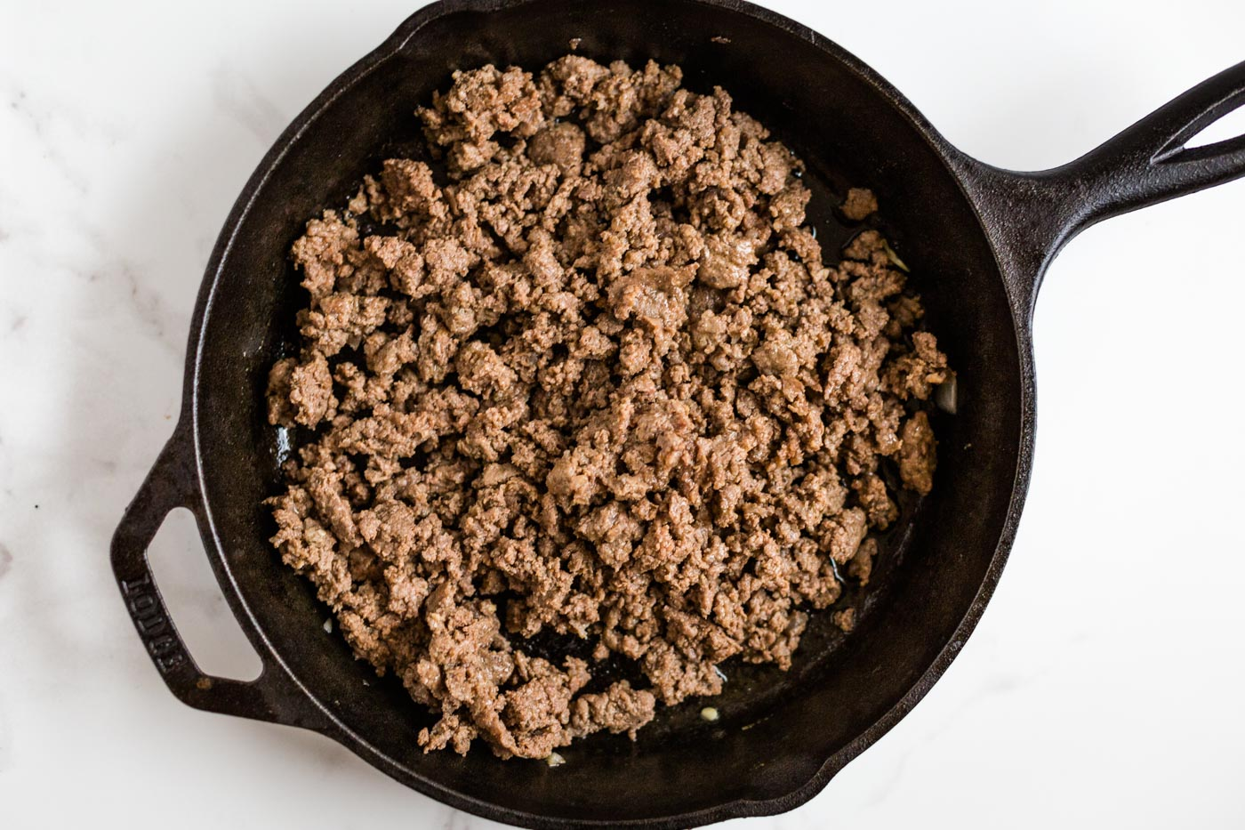 Cooked Breakfast sausage in cast iron skillet