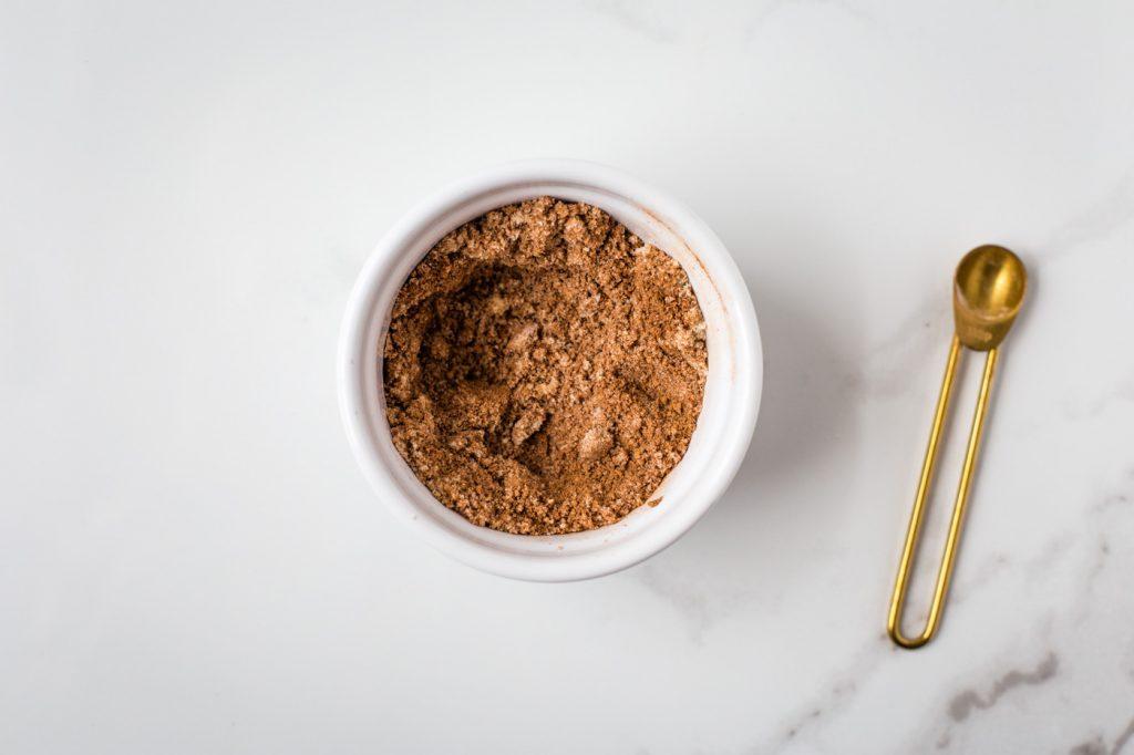 dry ingredients to mug brownie in white ramekin