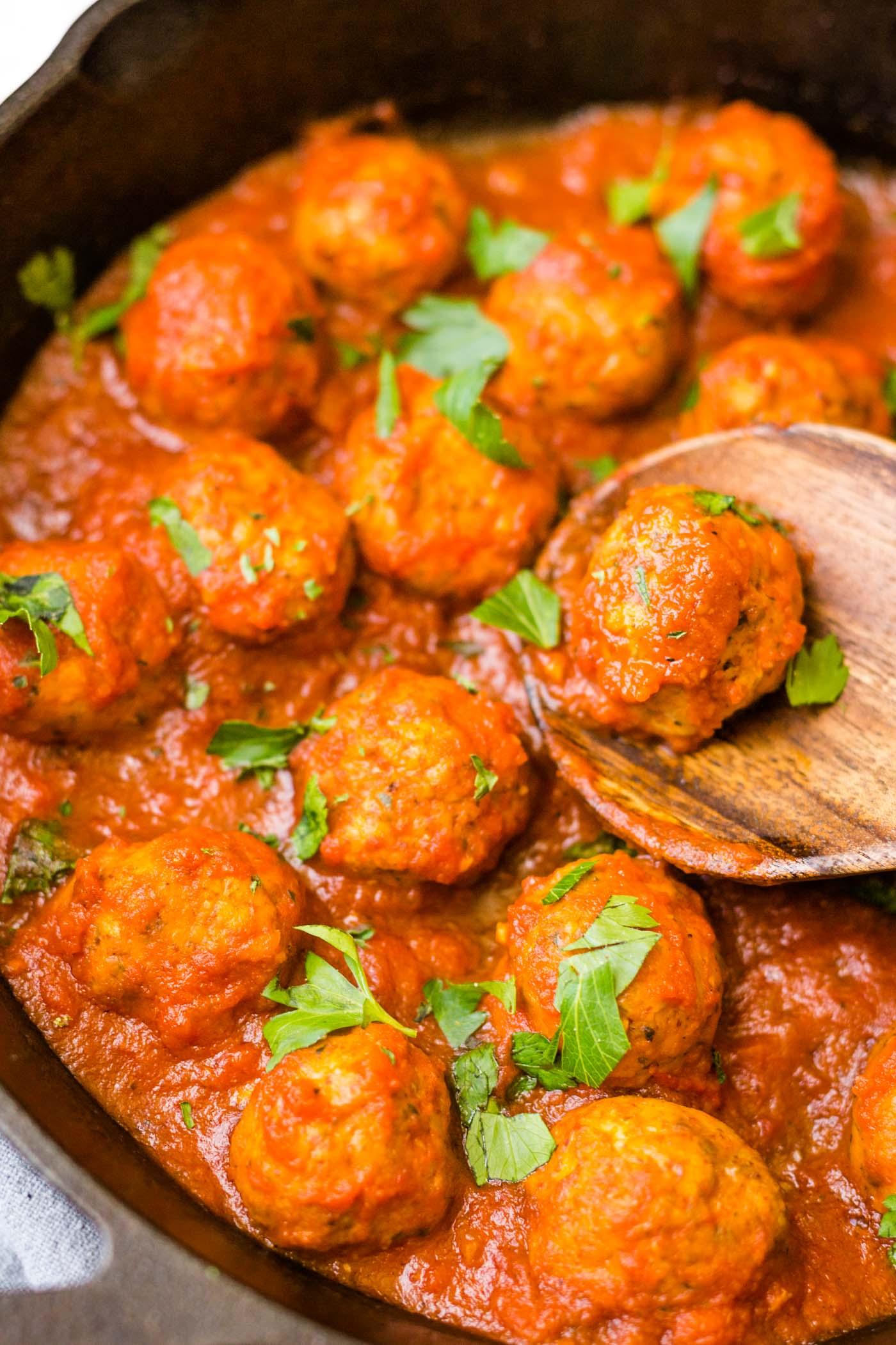 Italian Paleo Chicken Meatballs in cast iron skillet