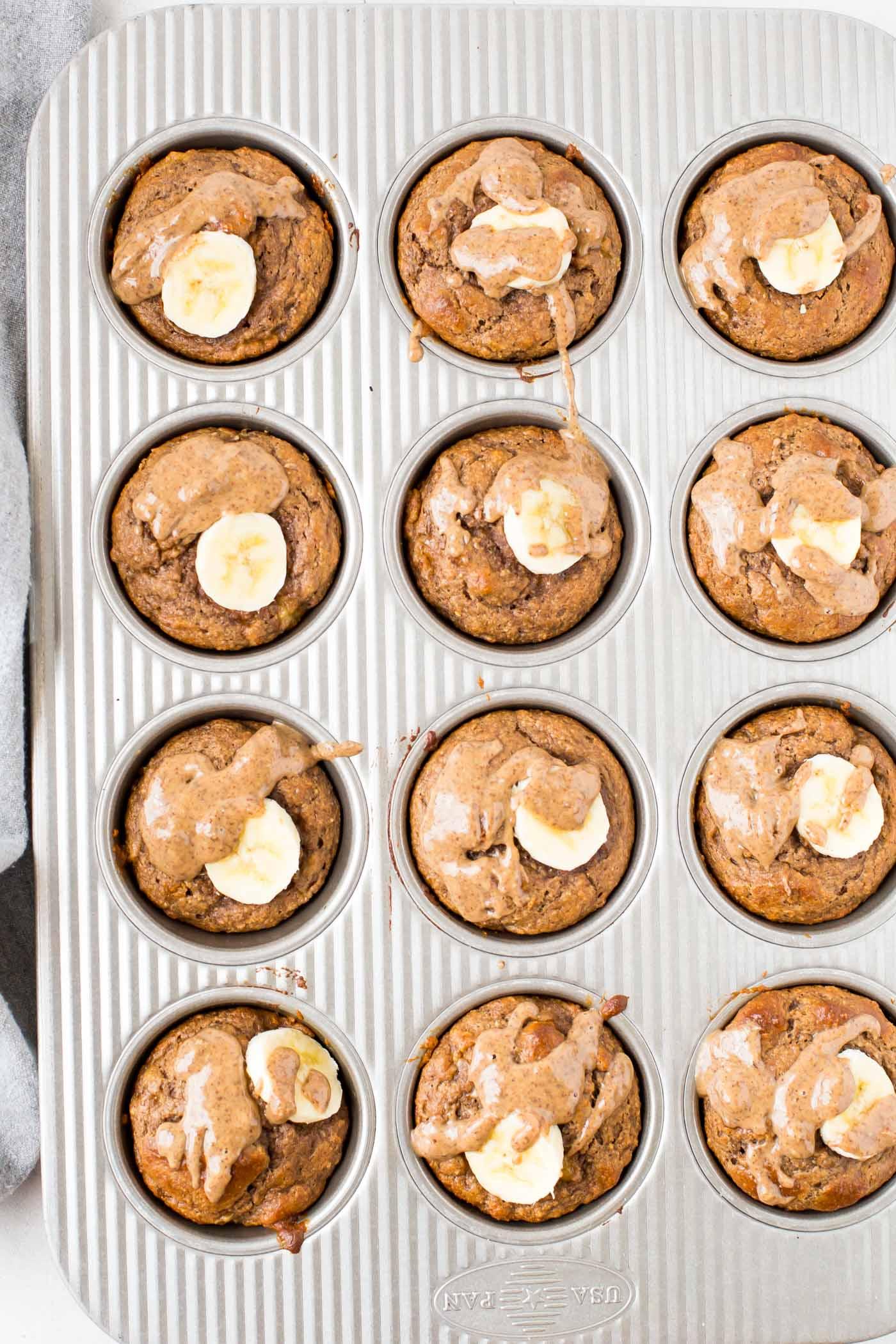 Twelve Banana Protein Powder Muffins in a muffin tin pan