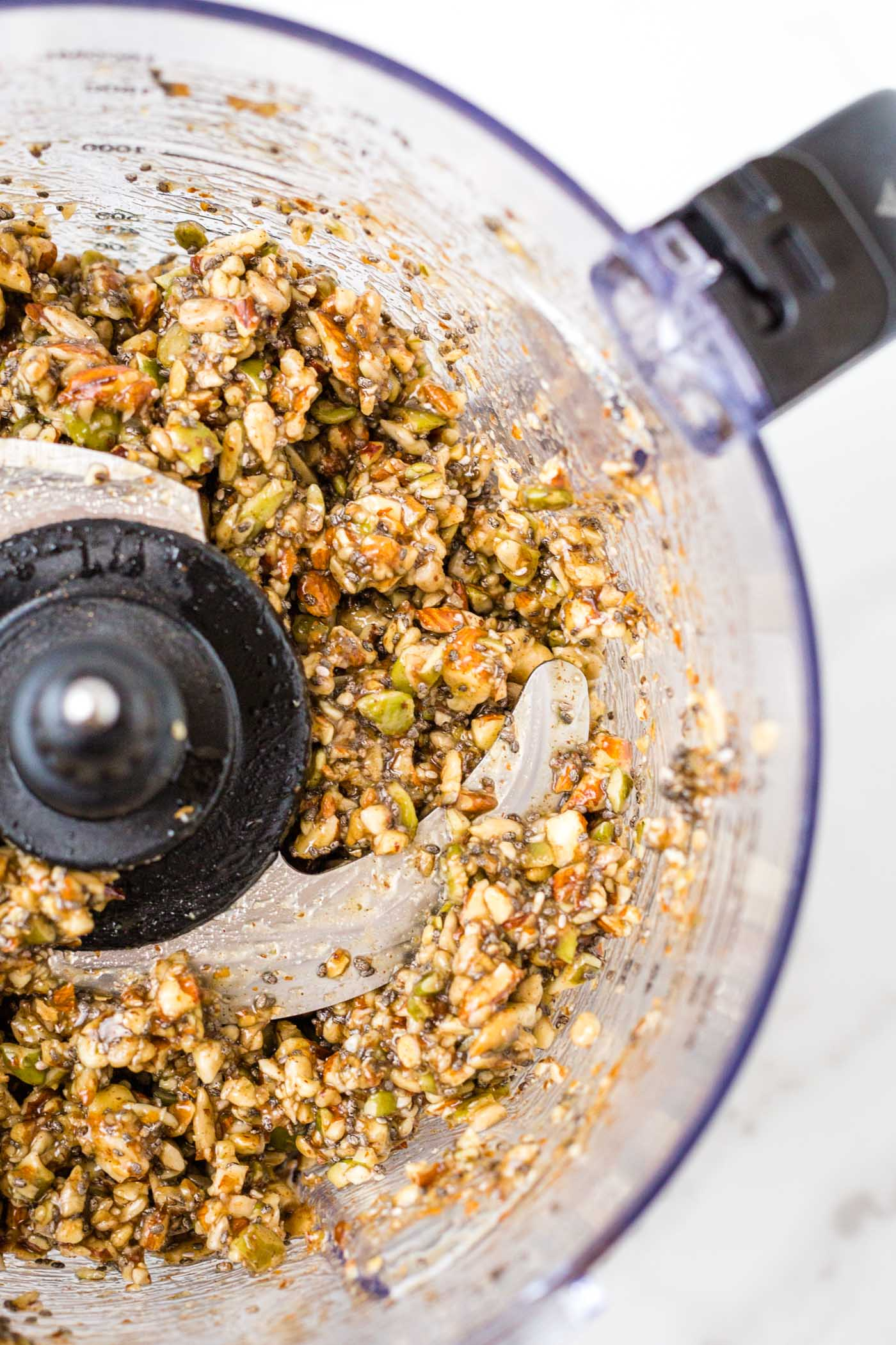 paleo granola chopped up in food processor