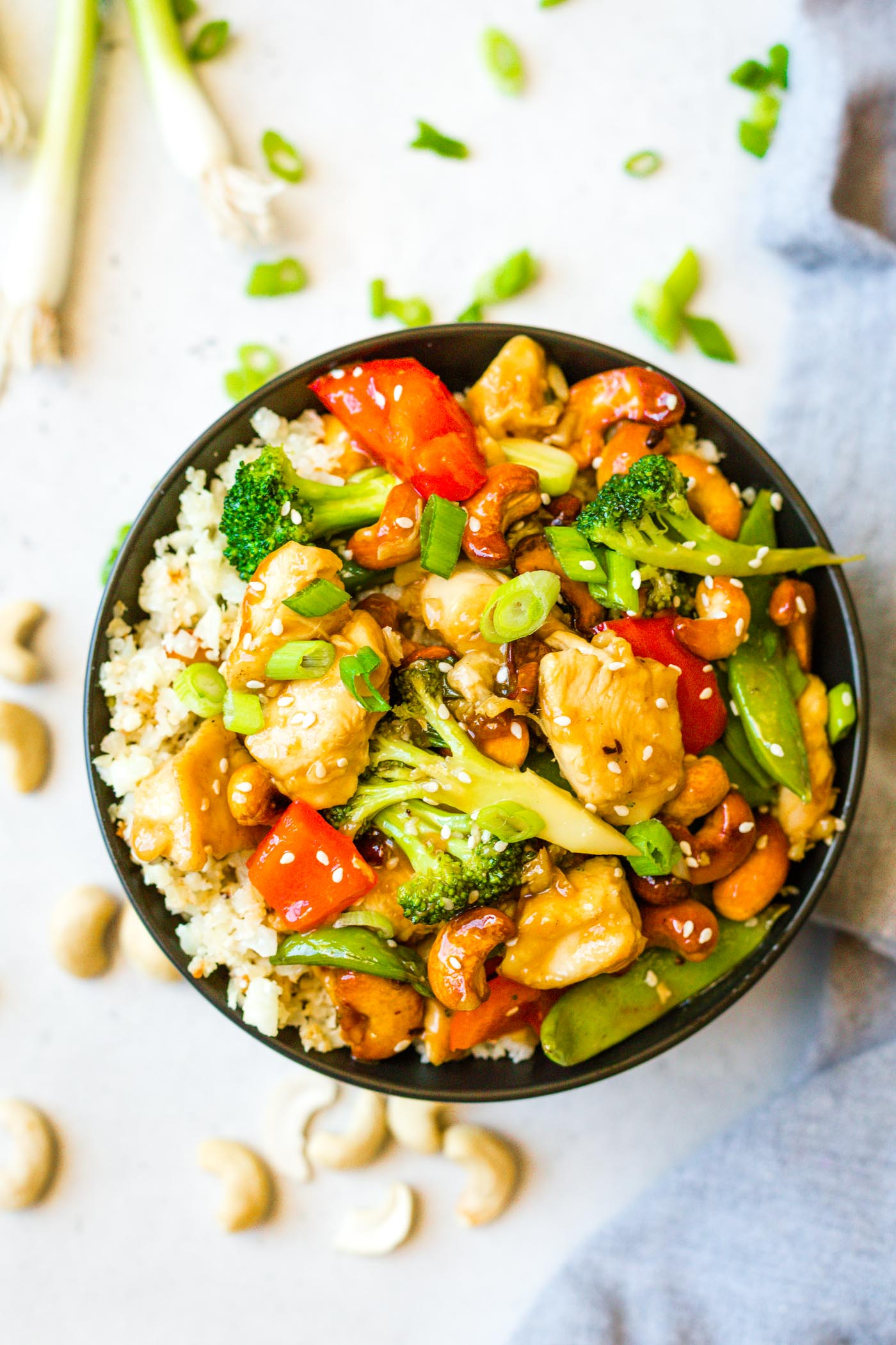 Black bowl filled with paleo cashew chicken