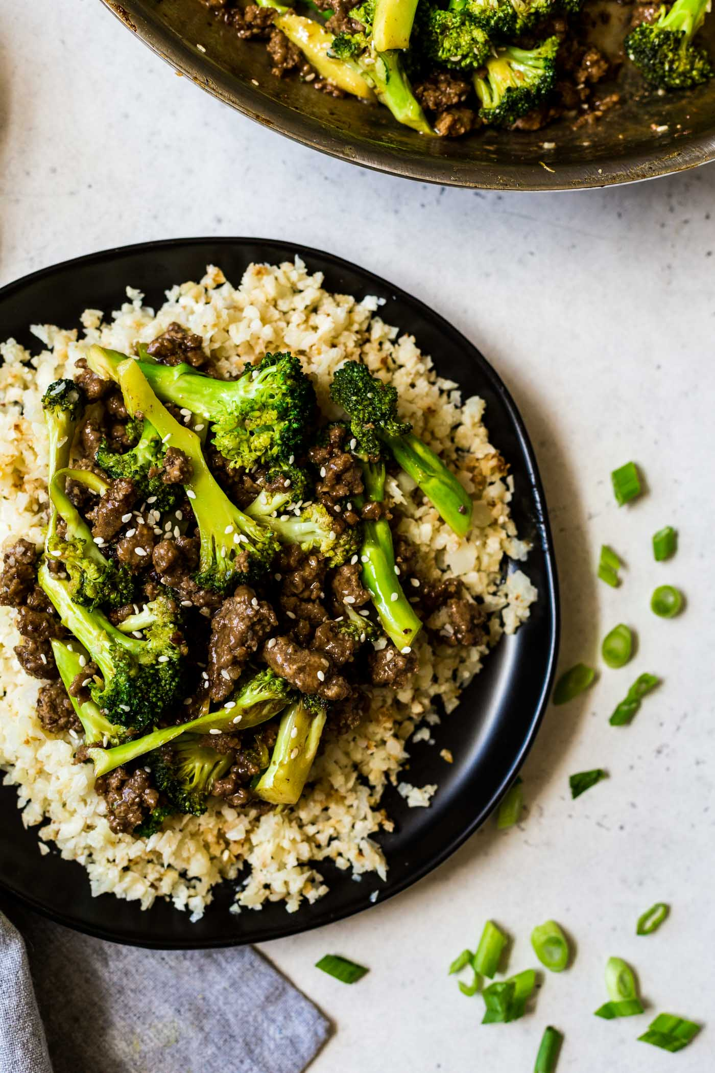 Black plate with cauliflower rice and ground beef and broccoli