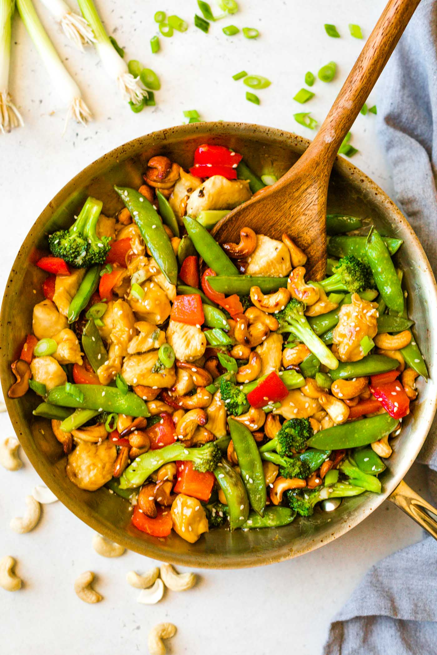 Keto Cashew Chicken in skillet with wooden spoon