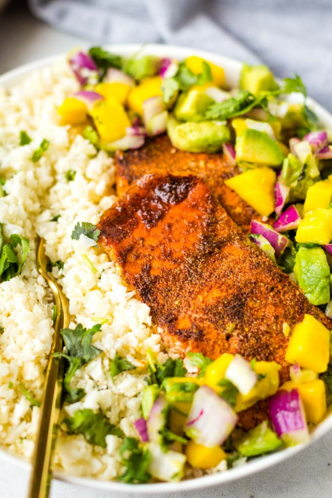 Chili Lime Salmon bowl with avocado and mango salsa and cauliflower rice