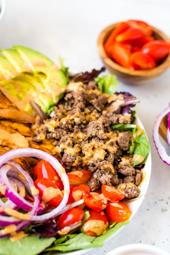 burger salad drizzled with special sauce