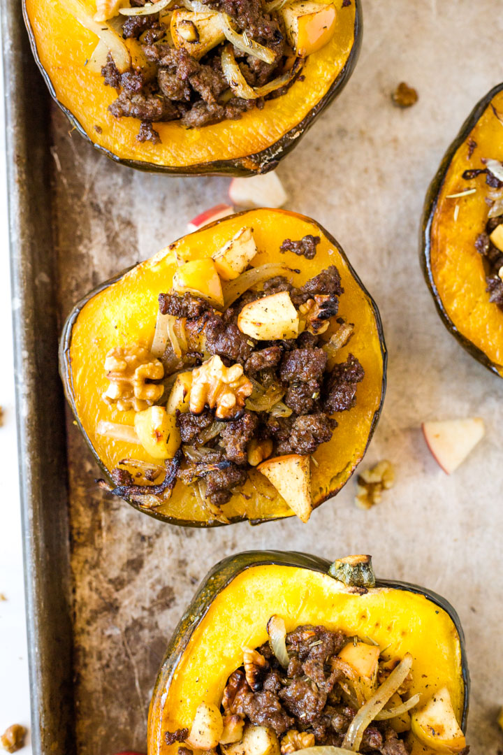 Whole30 stuffed acorn squash on baking sheet