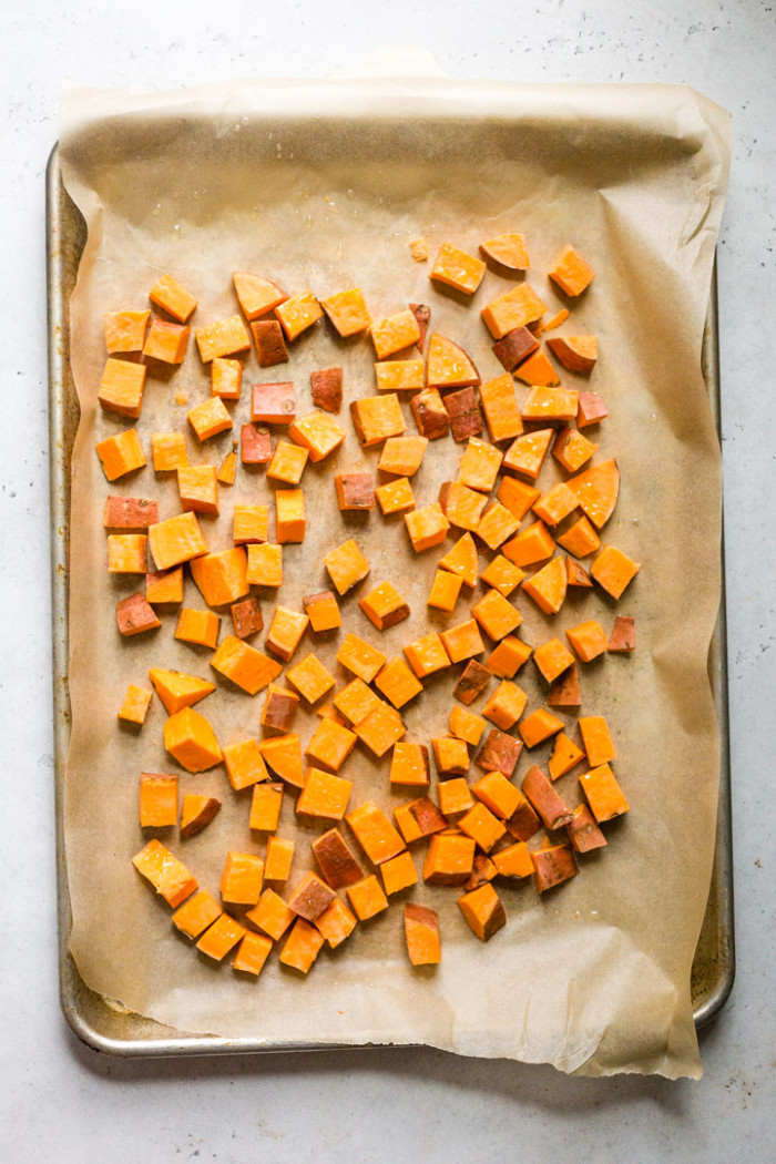 Cubed uncooked sweet potatos on a baking sheet