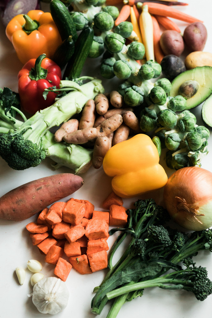 assortment of vegetables, potatoes, and avocado