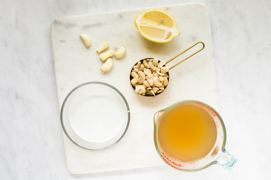 an overhead shot of the ingredients for this coconut-cashew dairy-free cream sauce
