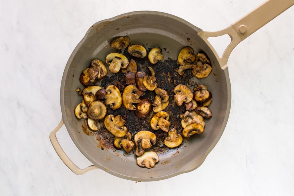 sauteed mushrooms in skillet